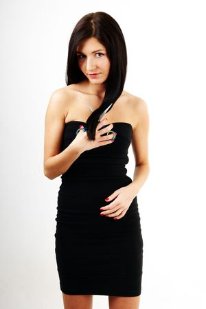 nice woman cutting her long dark hair Stock Photo - 6883321