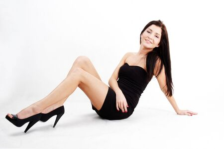 attractive young brunette woman sitting photo
