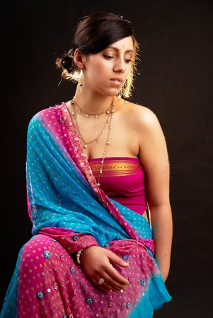Beautiful indian brunette woman portrait with traditional costume  Stockfoto