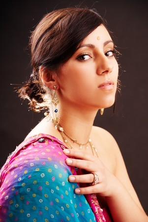 Beautiful indian brunette woman portrait with traditional costume Stock Photo - 8988099