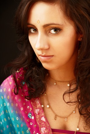 Beautiful indian brunette woman portrait with traditional costume  Stock Photo