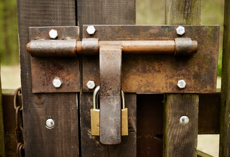 padlock on an old wooden fence photo