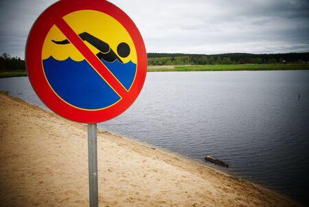 no swimming sign at the local lake photo