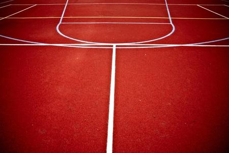 center court: red basketball playground