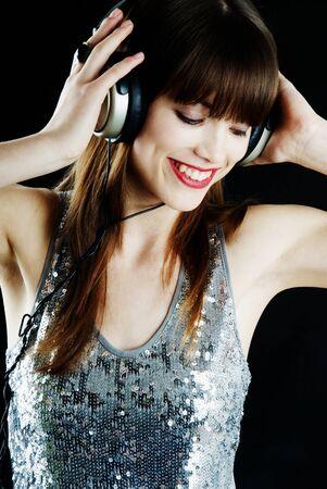 vrolijke vrouw met hoofdtelefoon Stockfoto