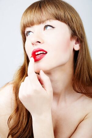 elegant and sexy woman eating a jelly sweet photo
