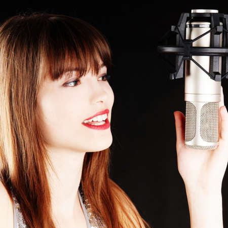 young artist woman recording in a studio photo