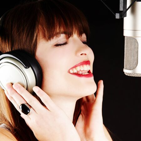 young artist woman recording in a studio Stock Photo