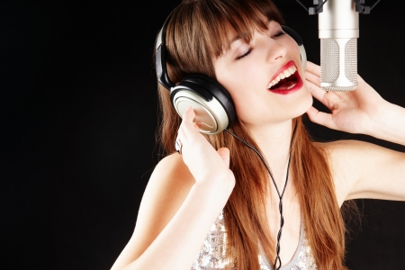 recording studio: young artist woman recording in a studio Stock Photo