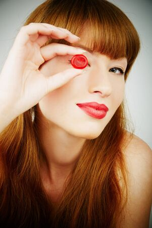 woman with a candy Stock Photo - 10117522