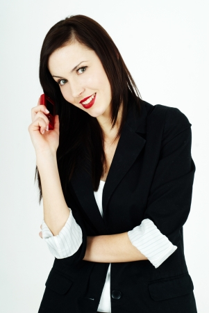cheerful woman holding a mobile phone Stock Photo