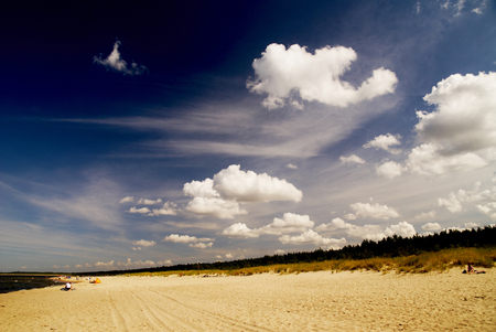 Beautiful cloudy sky during a hot summer day at the seaside Stock Photo