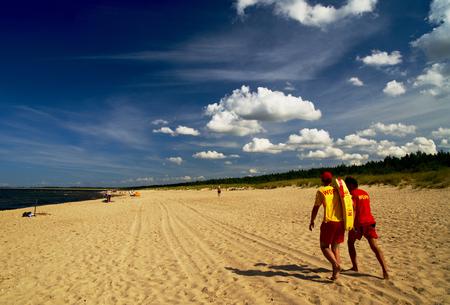 Lifeguards walking at the seaside Stock Photo