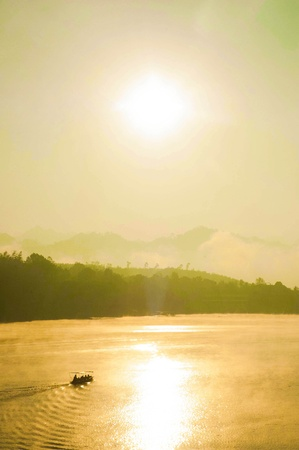 People were floating in the morning  There is fog cover mountains photo