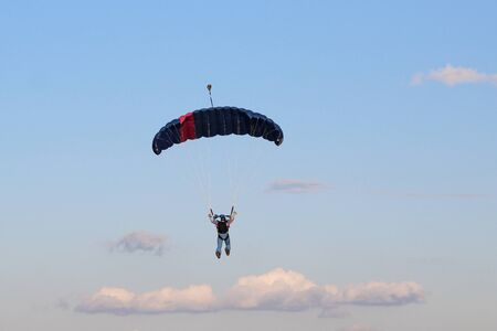 PARATROOPER IN THE SKY WITH CLOUDS Stock Photo