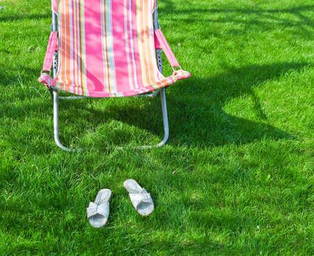 grassplot: Chaise lounge and mules on a grassplot
