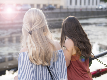 Two girls on the bank of a river