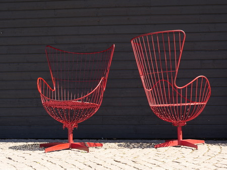 some designer chairs in front of a black background