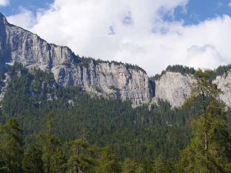a big rock wall in the swiss mountains