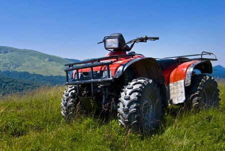 red quad on romanian highlands Reklamní fotografie