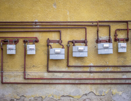 gas meters on an old building photo