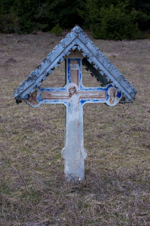 old crucifix with tin roof
