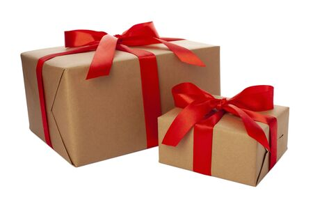 Beautiful gift boxes with red ribbon and bow isolated on white. Many presents for Christmas wrapped in craft paper on white background, front view, above view 版權商用圖片