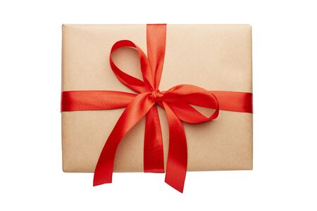 Beautiful gift box with red ribbon and bow isolated on white. One present for Christmas wrapped in craft paper on white background, front view, top view 版權商用圖片