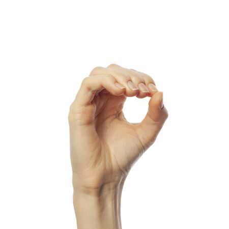 Finger spelling letter O in American Sign Language on white background. ASL concept