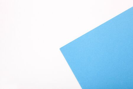 White and blue pastel paper texture as background. Top view