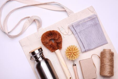 Eco-friendly kit on color background. Composition with zero waste objects. Top view with place for text