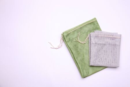 Cotton bags on white background. Zero waste concept. Top view with place for text 版權商用圖片