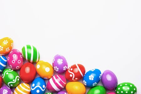 Flat lay composition made with Easter eggs on light background. Top view with place for text Archivio Fotografico