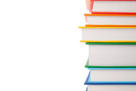 Stack of colorful books isolated on white background. Collection of different books. Hardback books for reading. Back to school and education learning concept. Copy space text, closeup view