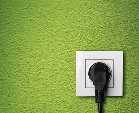 electric plug: Electric outlet with cable plugged  Stock Photo