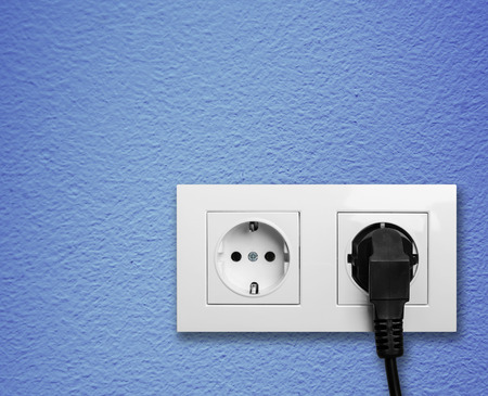 Electric outlet with cable plugged  Stock Photo