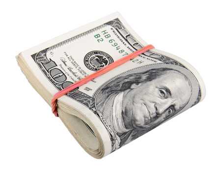 Hundred dollar bills rolled up with rubberband photo