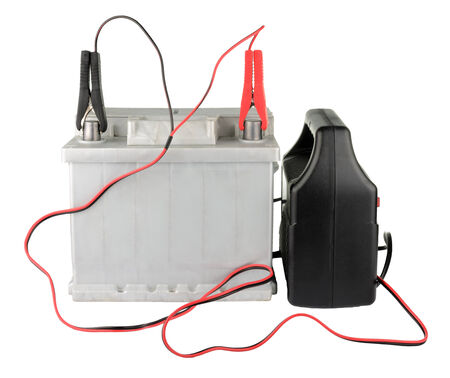 12v: Car battery clipped to the terminals isolated on white  Stock Photo