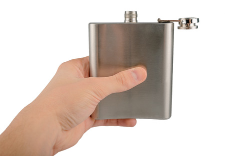 hip flask: Male hand holding stainless hip flask isolated on a white