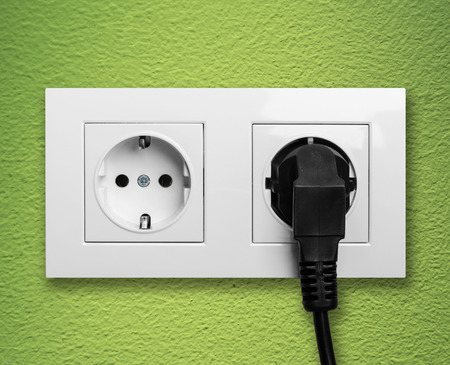 plugged: Electric outlet with cable plugged Stock Photo