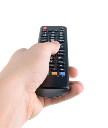 Male hand holding tv remote control isolated on white photo