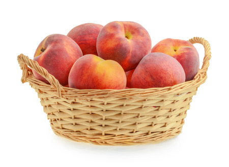 peaches in basket isolated 写真素材