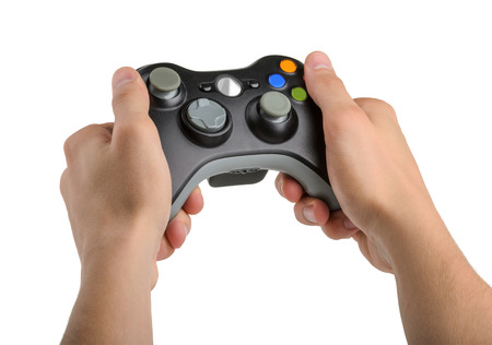 gamepads: Male Hands Holding Gamepad isolated