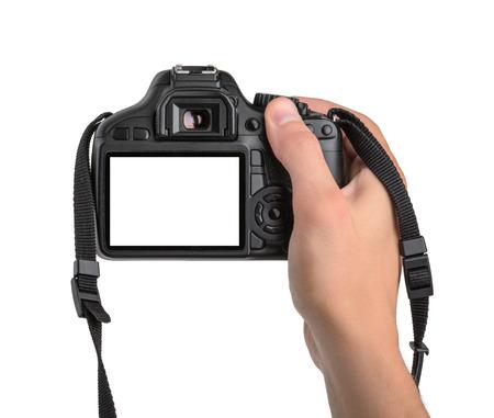 při pohledu na fotoaparát: DSLR v ruce izolovaných Reklamní fotografie