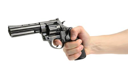 白い背景の上の手でリボルバー銃