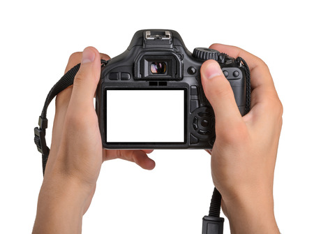 slr camera: DSLR camera in hand isolated
