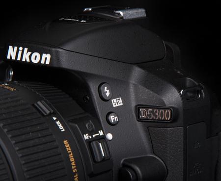 KYIV, UKRAINE - JUNE 19, 2015: Nikon d5300 camera with sigma 17-50mm f2.8 lens on black background