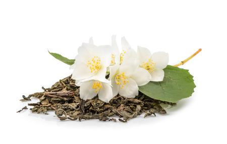 dried herbs: jasmine tea with jasmine flowers isolated on white background