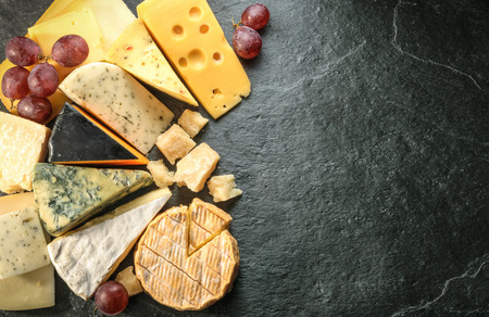 Various types of cheese with empty space background Imagens