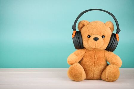 the copy: Teddy Bear with headphones with copy space